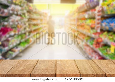 Empty top wooden table and sunny blurred shopping supermarket background. for product display