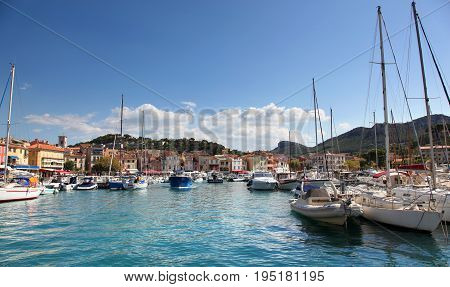 Boat filled harbor of Cassis France on a sunny day
