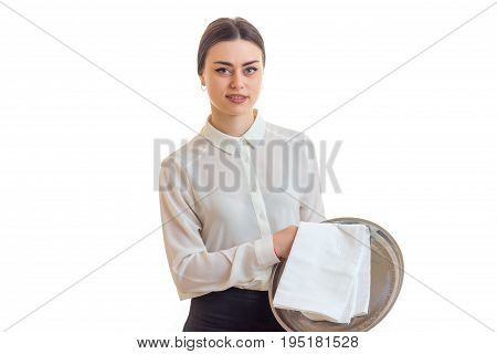 cute girl waitress in uniform with trey in hands isolated on white background