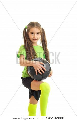 cutie little girl with soccer ball in hands looking at the camera isolated on white background