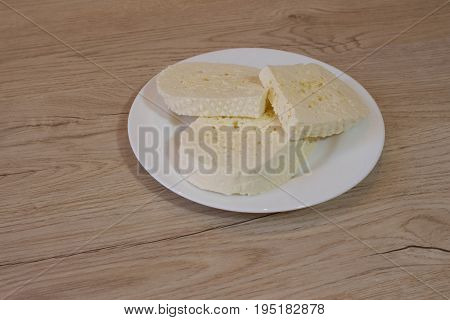 Imeretian cheese Cut on a plate. a traditional white Georgian cheese named Imeretian cheese