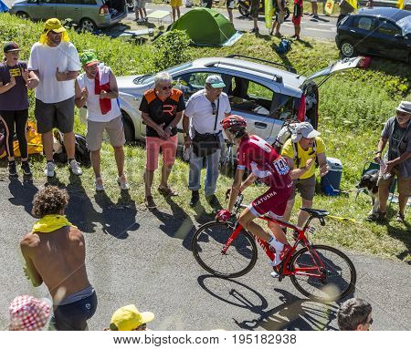 Col du Grand ColombierFrance - July 17 2016: The Russian cyclist Ilnur Zakarin of Katusha Team riding on the road to Col du Grand Colombier in Jura Mountains during the stage 15 of Tour de France 2016.