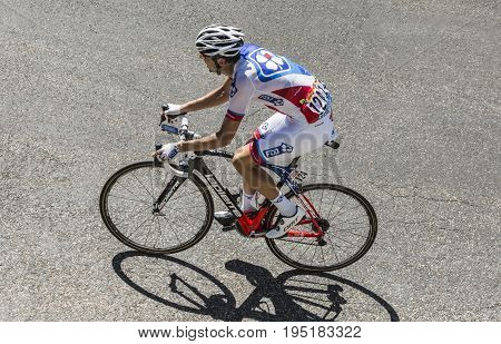 Col du Grand ColombierFrance - July 17 2016: The Swiss cyclist Steve Morabito of FDJ Team riding on the road to Col du Grand Colombier in Jura Mountains during the stage 15 of Tour de France 2016.