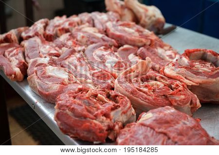 Fresh raw meat on counter in market