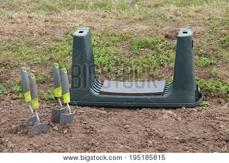 A Gardening Kneeling Pad with Two Trowels and Forks.