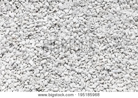 Natural matte white color pebble stones. background image texture