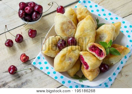 Fried Pies. Pies Sweet With Cherries On The Kitchen Table In A Rustic Style. Copy Of Space.
