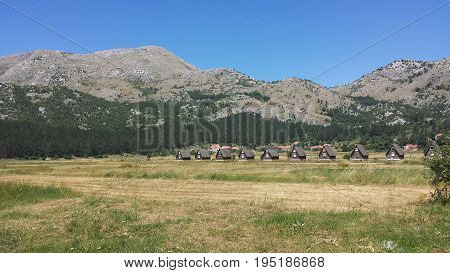 Small cottages in the village of Njegusi (Montenegro) in the glade among the mountains