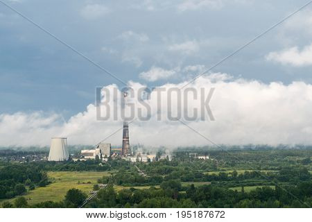 Heat power station with clouds of steam around them