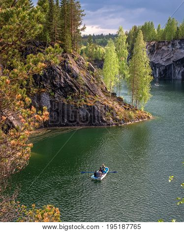 Ruskeala, Sortavala, Republic of Karelia, Russia - June 12, 2017: Marble quarry in Ruskeala Park. Ruskeala located on the ground filled with groundwater former marble quarry. Tourists go boating.