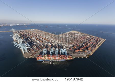 Los Angeles, California, USA - July 10, 2017:  Sprawling Los Angeles Harbor Pier 400 with Hyundai cargo ship unloading containers.