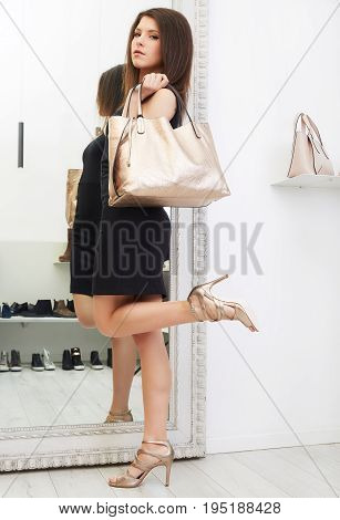 Happy woman shopping for clothes and shoes