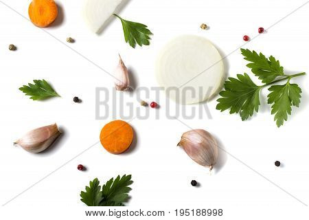 Parsley leave with vegetables and colored peppercorns isolated on white background - top view