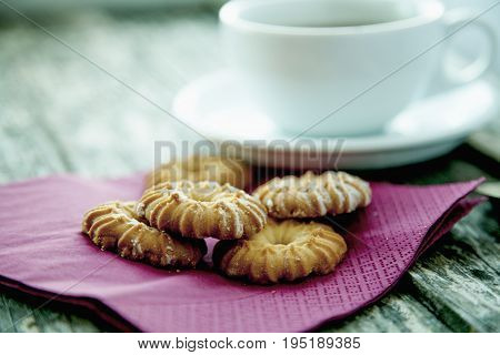 Close up of cup of tea with dumplings on a vintage on wooden background (Taste thirst drink concept)