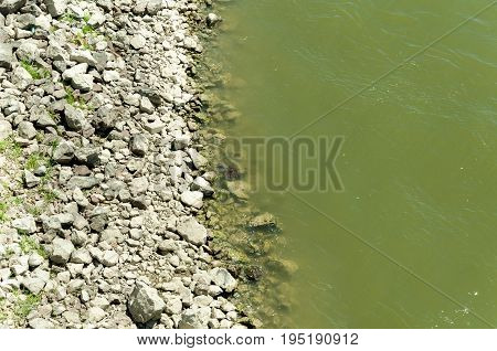 Rocky shoreline on Danube river. View from above.