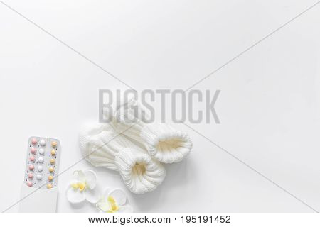 Female contraception pills on white background top view copyspace.
