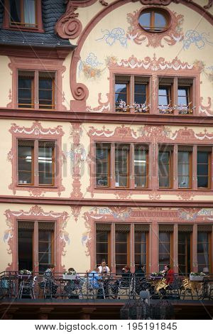 MAINZ, GERMANY - APRIL 20: The listed facade of the historic building and cafe Zum Boderam painted with ornaments on the Gutenberg Square on April 20, 2017 in Mainz.