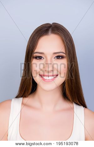 Close Up Cropped Photo Of Young Cute Charming Lady Standing On The Pure Light Blue Background And Sm