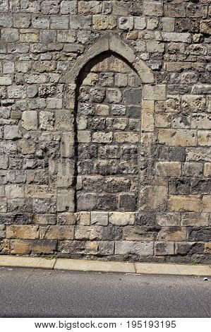 Medieval stonework with an arch set in the city walls of the historic city of York
