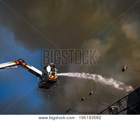 KIEV UKRAINE - Jun 20 2017: Firefighters in action. Firefighters try to extinguish a fire in a three-story house in Kiev