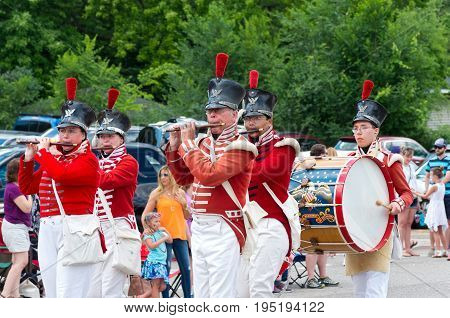 MENDOTA, MN/USA - JULY 8, 2017: Fort Snelling fife and drum corps march through the historic city of Mendota during the annual parade. The city is one of the first permanent settlements in Minnesota.