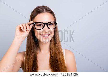 Happy Young Girl Is In A Stylish Glasses, Wearing Casual Singlet, Holding Her Eyewear, Smiling On Pu