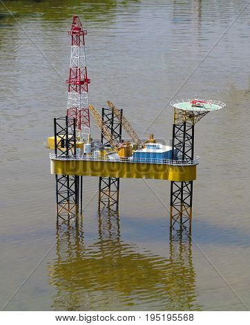 Model of modern oil rig platform standing on water