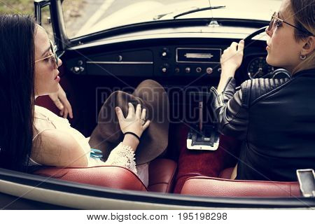 Women Couple Driving a Car Road Trip Together