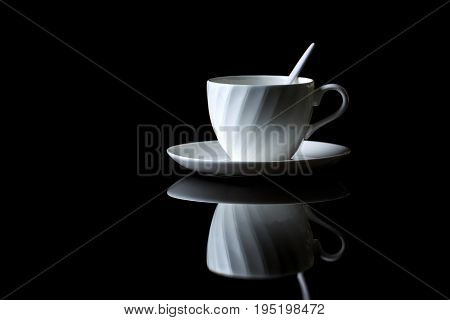 Cup Of Coffee On A Black Reflective Background