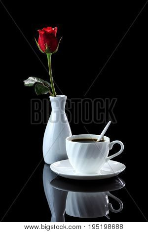 Composition With Cup Of Coffee And Rose On A Black Reflective Background With Backlight