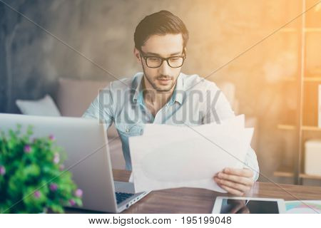 Close Up Photo Of Concentrated Young Middle Eastern Businessman, Typing On His Laptop At The Office.