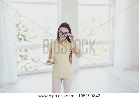 Brunette Woman Realtor With Beaming Smile Is Welcoming You In New Apartment, Show You Around, Long B