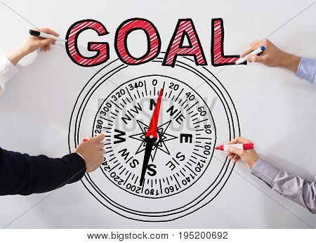 Business People's Hand Drawing Goal Concept And Compass Diagram On White Background