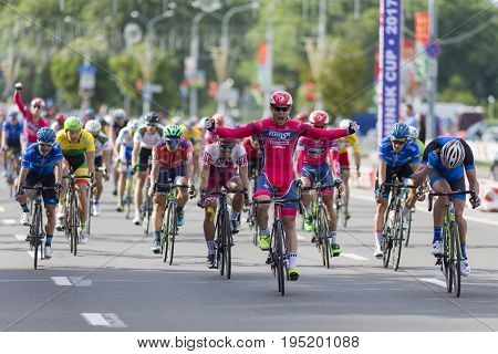 Minsk Belarus-July 8 2017: Evgeny Korolek from Belarus Crossing the Finish Line in Front of Peloton During International Road Cycling Competition Grand Prix Minsk-2017 on July 8 2017 in Minsk Belarus