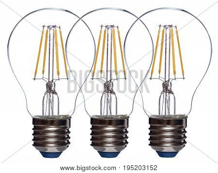 Row of three LED bulbs isolated on white background.