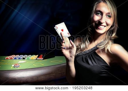 gambler woman win at blackjack casino table