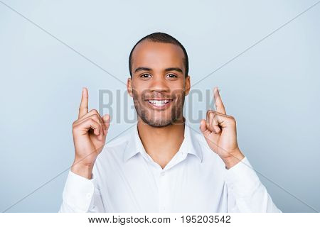 Look Up! Young Mulatto Man With Beaming Smile Is Pointing Up With His Fingers, Wearing Classy Outfit