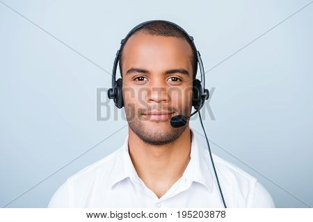 Attractive Friendly Mulatto American Guy - Call Centre Operator In A Headset. He Is Isolated On A Pu