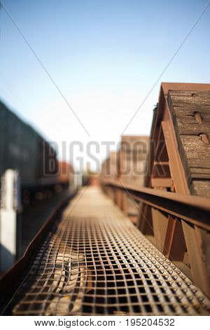 Heat-deformed metal net on a wooden freight train wagon
