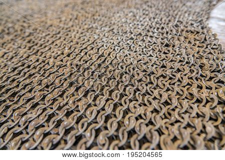 Medieval knight's armor mail frame. With flat rings that make chain slaves.Texture of chainmail of a medieval armor knight, Pattern, background, closeup, detail
