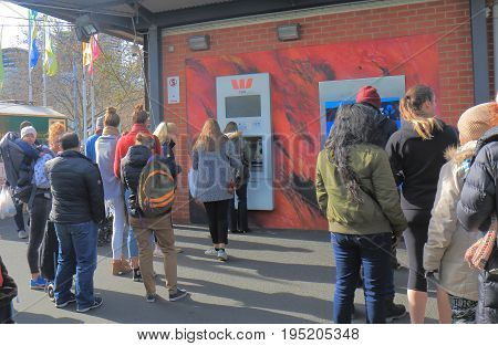 MELBOURNE AUSTRALIA - JULY 2, 2017: Unidentified people queue for ATM in Melbourne.