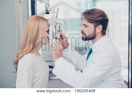 Health Care, Medicine, Eye Sight And Technology Concept. Side Profile Photo Of Brunet Bearded Optici