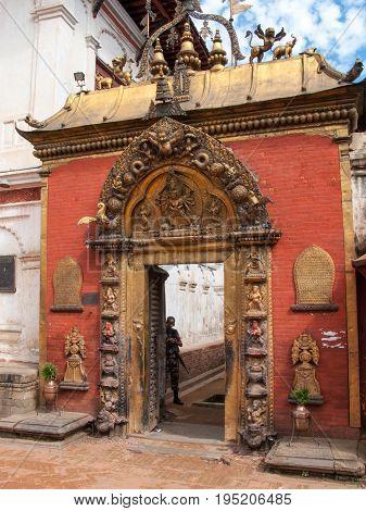 KATHMANDU, BHAKTAPUR, NEPAL. 30 September 2008:  The main entrance of the Palace of fifty five Windows, Golden gate Sun Dhoka. Durbar Square in Bhaktapur, Kathmandu valley