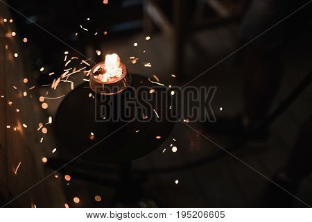Sparks from the burning coals hookah. Hookah tobacco in bowl