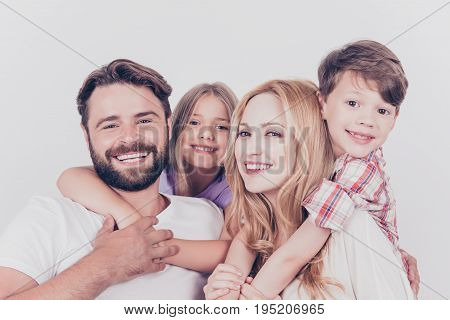 Family Photo Portrait. Four Relatives Are Hugging On The White Background, Smiling, At Home, Blond M