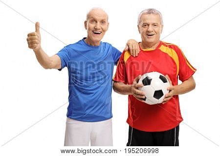 Seniors dressed in jerseys with one of them holding a football and the other making a thumb up gesture isolated on white background