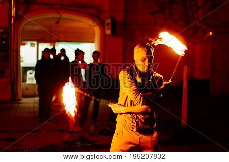 The Guy On The Street Performs With Fire Torches