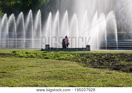 Yekaterinburg, Russia - May 31, 2017: Two Women On The Embankment Near The Waterworks On The Iset Ri