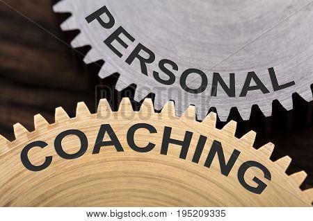Closeup of personal coaching concept on interlocked cogwheels