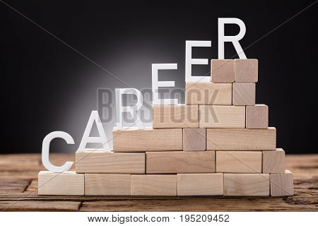 Closeup of career text on steps made of wooden blocks on table